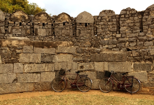 BICYCLES blending into the surrounding ancient walls of Rajagiri Fort in Pondicherry, India.
