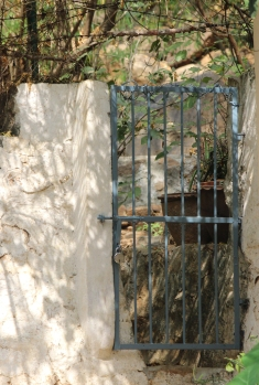 Next to the entrance of a significant cave in Tiruvannamalai India, stood a single wall and this gate. One could easily walk around the wall to get to the other side rather than using the gate.