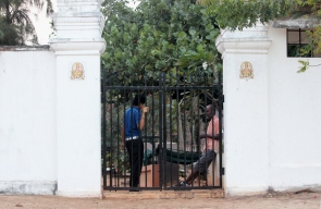 The hotel entrance to the beach in Pondicherry, India. Women must be off the beach before sundown.