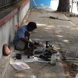 COIMBATURE. Shoe repairman sets up shop.